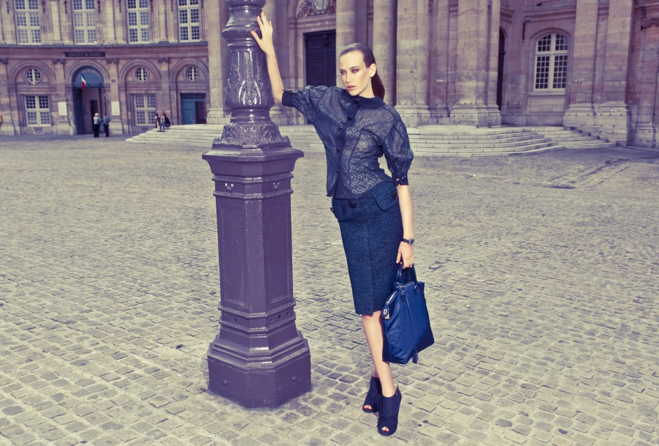 Top, skirt, and bag by LOUIS VUITTON; shoes by MIU MIU; watch by DIOR HORLOGERIE