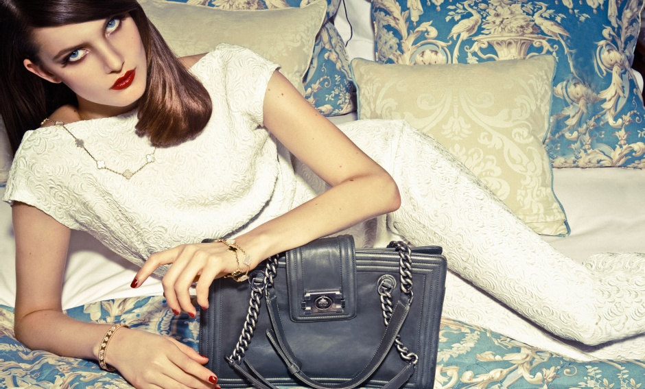 Top and trousers by JEAN PAUL GAULTIER; bag by CHANEL; necklace and bracelets by VAN CLEEF & ARPELS