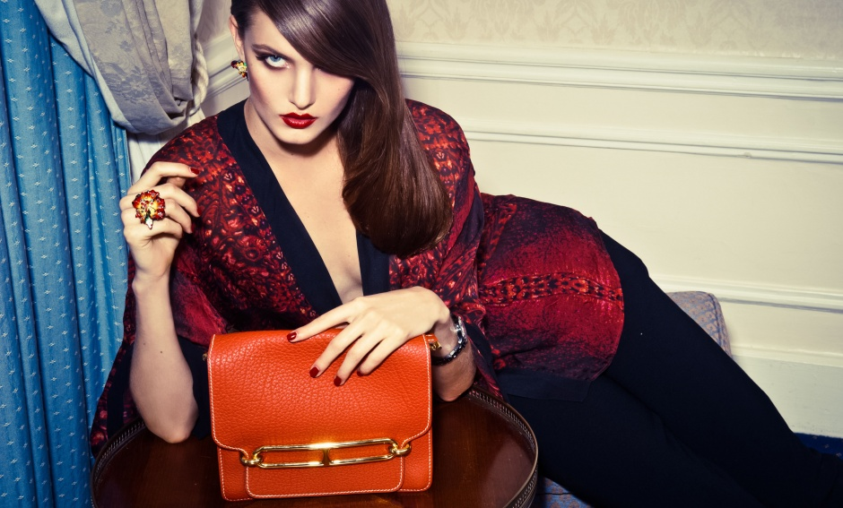 Cardigan and bag by HERMÈS; ring and earrings by DIOR JOAILLERIE; watch by DIOR HORLOGERIE