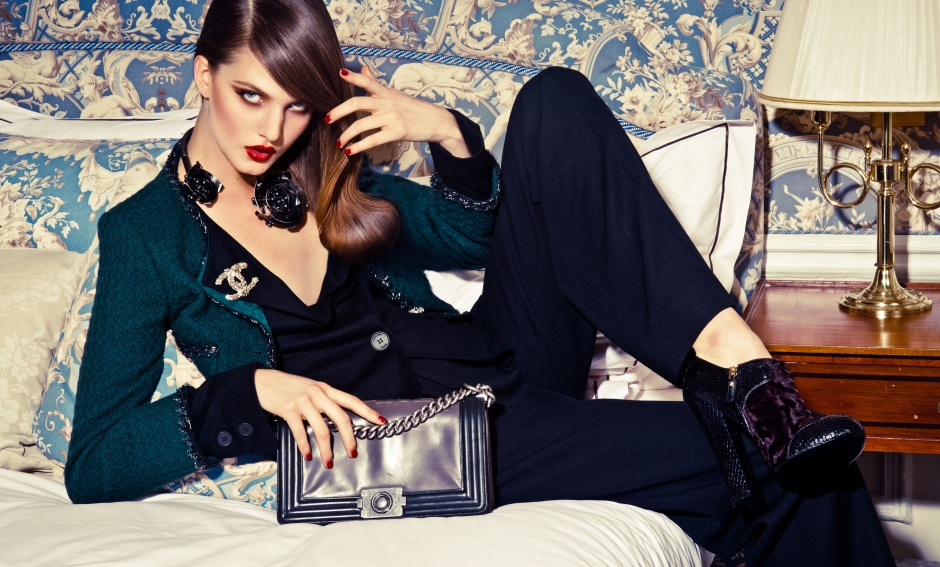 Jacket, trousers, bag, and brooch by CHANEL; necklace by LANVIN; boots by LOUIS VUITTON