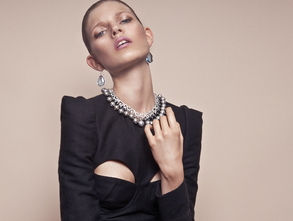 Dress by CARVEN; Earrings and necklace by CHOPARD