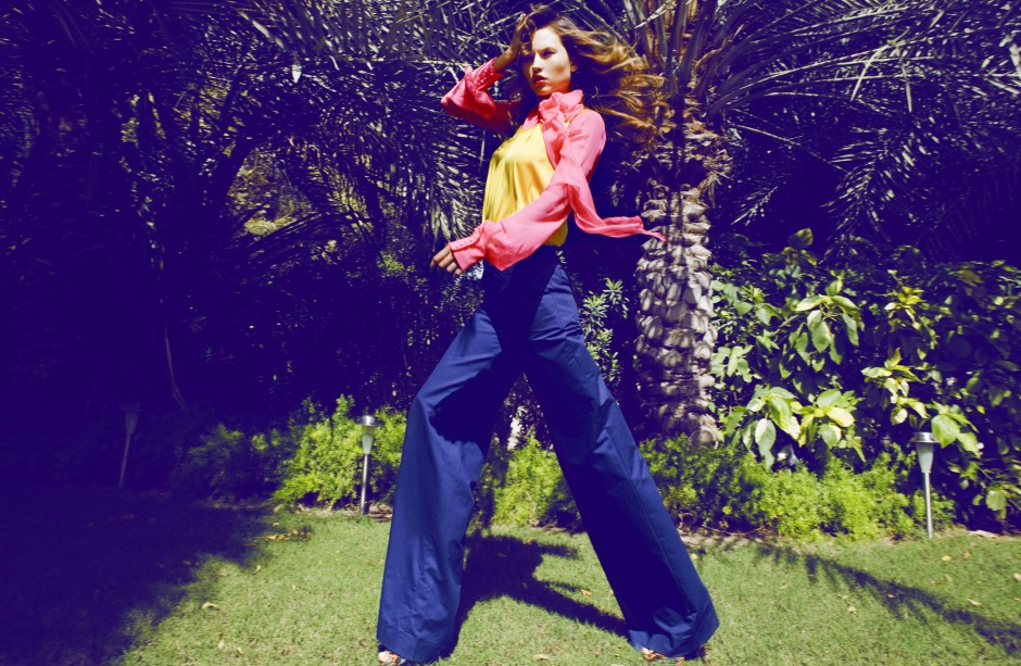 High-waisted trousers, Dior Chiffon blouse, Antonio Berardi at Saks Fifth Avenue Silk tank top (worn over), Elie Tahari at Saks Fifth Avenue Ring, Loulou & Yasmine at Marami